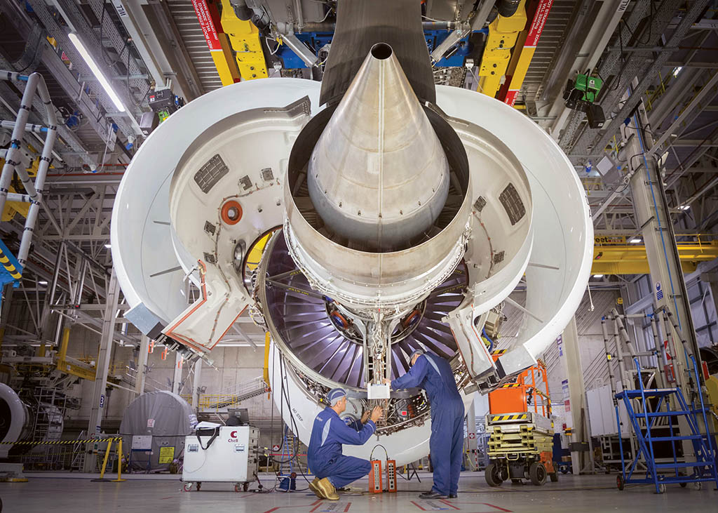 Mechanics working on the inner workings of a plane